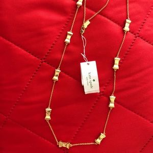 Kate Spade gold bows long necklace NWT